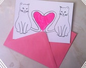 Hand drawn valentines card/postcard with two cats creating a neon pink heart with their tails