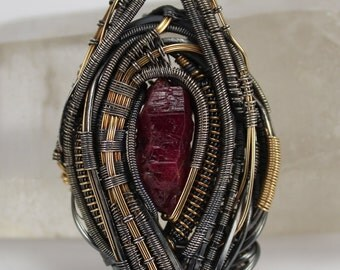 Wire wrapped pendant with ruby crystal in sterling silver and 14/20 gold fill