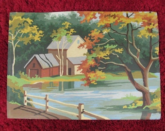 Vintage paint by number Autumn scene with house, lake, and oak trees