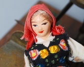 Vintage clay  figurine doll in national dresses.