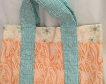 Orange and blue flowered six pocket tote