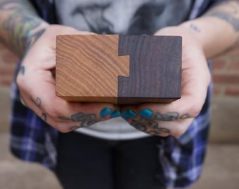 Dovetailed salt and pepper shakers. 3 x 3 x 1.5. Elm and Walnut