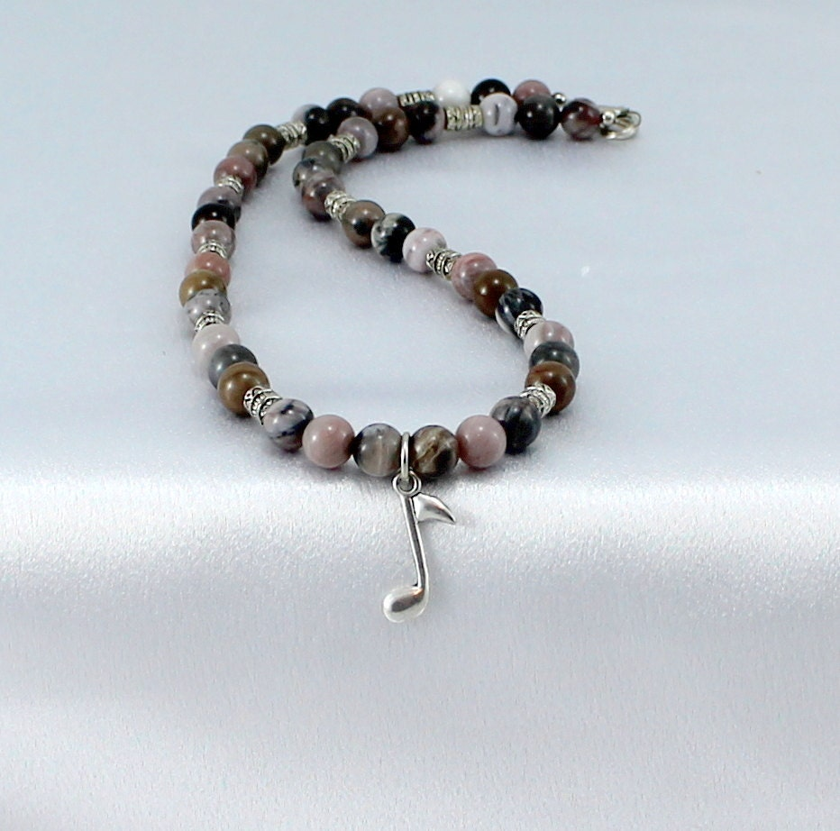 petrified wood necklace with musical note pendant high