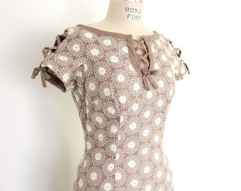 50s Wiggle Dress, White Tan Neutral Pin Up Bombshell embroidered lattice peekaboo cutouts lace up taupe cotton mid century minimalist frock