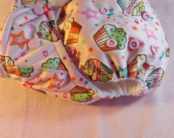 SassyCloth one size pocket cloth diaper with cupcakes in pink PUL print. Made to order.