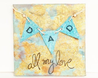 Mixed media altered canvas for Father's Day with a blue canvas banner on a blue and gold canvas saying DAD all my love, Assemblage art