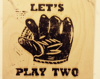 Let's Play Two, linocut print on wood panel