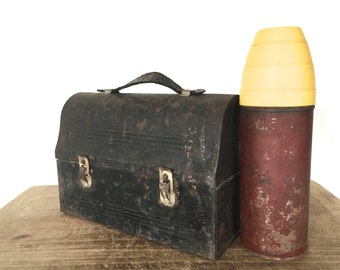 Antique tin lunch pail / box with a thermos inside
