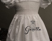 Girls custom smocked silk dupioni dress with band trimmed sleeves and pearls. Free matching bow.
