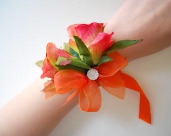 Red roses Wrist Corsages with Orange and Rhinestone Accent