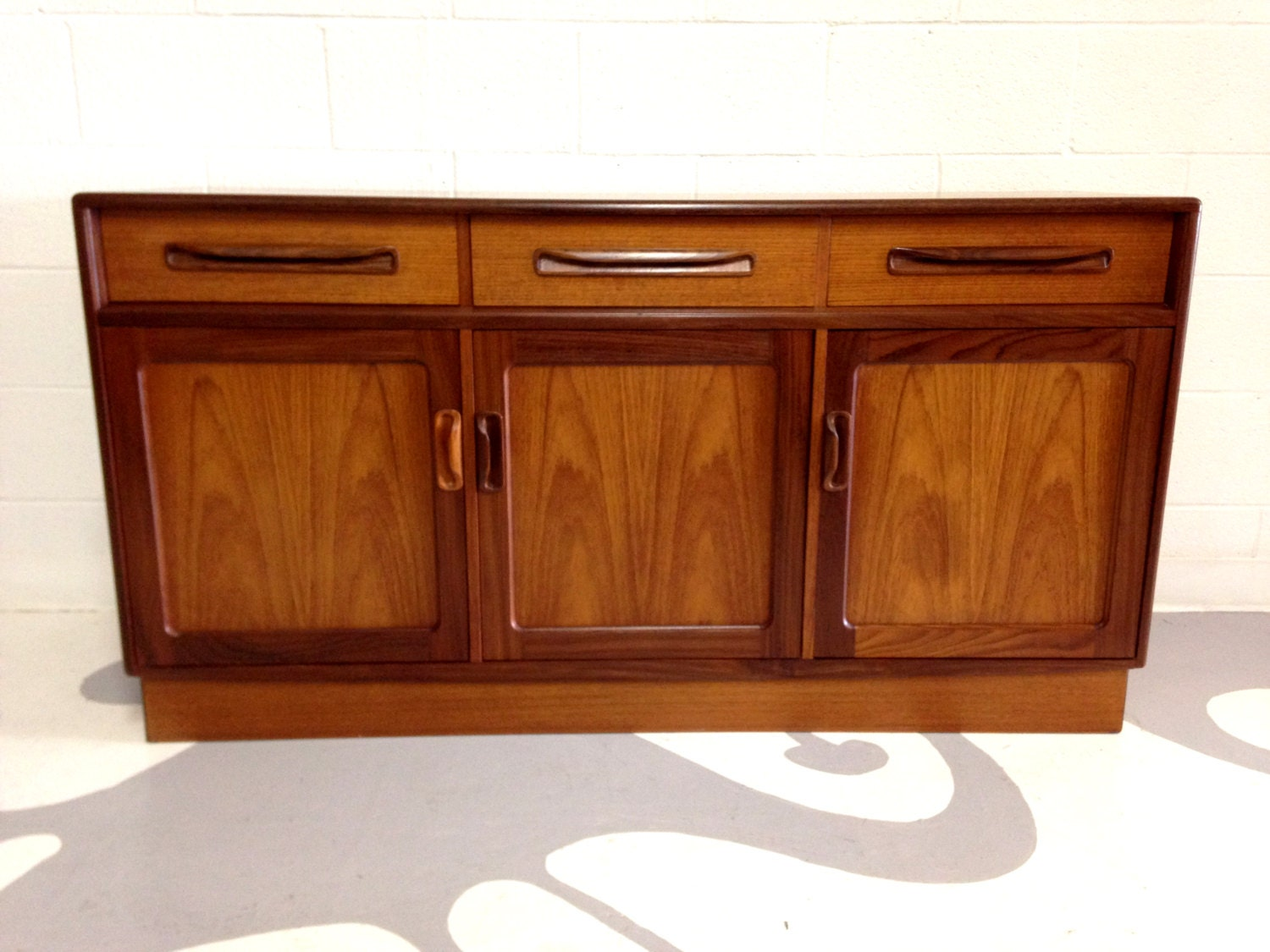 Mid Century Modern Buffet Credenza In Teak And Rosewood By Victor . Full resolution  portrait, nominally Width 1500 Height 1125 pixels, portrait with #450F04.