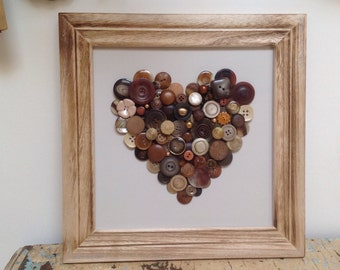 Beautiful framed heart made with vintage buttons