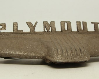 Vintage Plymouth trunk part