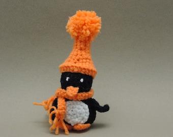 Crochet Amigurumi Penguin in an Orange hat and scarf