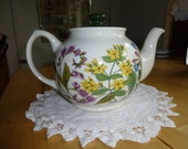 Sadler teapot showing English herbs, yellow loosestrife, lungwort, alknet. Bright colours. Made in England.
