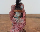 Becca Cook - Two Feathers- miniature sculpted native American figurine. Found items and poly clay.