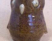 Stoneware bird jug with speckled brown glaze.