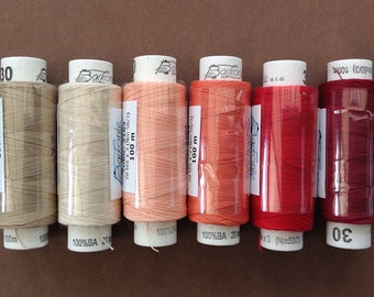 Six spools of Czech cotton lacemaking thread - cream, beige, peaches and reds colourway
