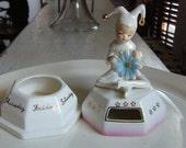 Ucagco Ceramic Pixie calendar turn style 2 piece white base  pink rim gold accent blue flower