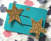 Chunky gold or blue glitter star hair slides