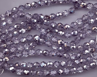 Two 8-inch strands (about 50 beads) 8 mm crystal/metallic pale tanzanite firepolished Czech beads - lot 892