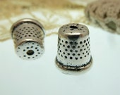 2 thimble  charm design  tibetian bead caps in antique silver