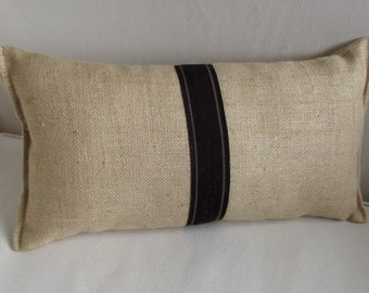 blonde burlap lumbar pillow with decorative tape in tobacco brown