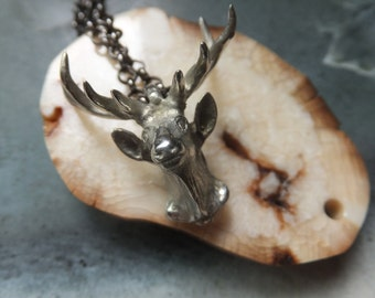 DEER necklace very cool and Awesome.  Great antlers Free shipping!