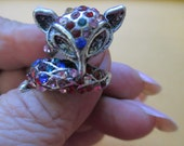 Vintage size 7 1/2 lady's silver tone fox wrap around ring colored rhinestones no markings