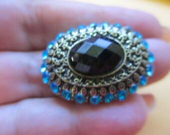 Vintage Jewelry Ladie's Ring adjustable antiqued brass toned finish aqua rhinestones no markings