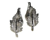 Coro leaf earrings turning textured leaf clip-on in silver tone