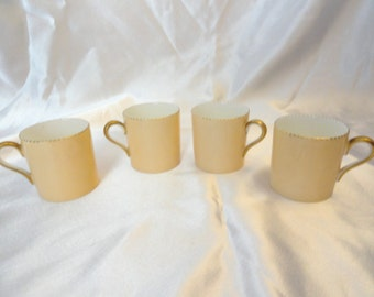 Set of four cups shown, Wedgewood bone china, made in England