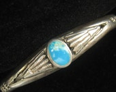 "SALE Small Old Pawn Sterling Silver Vintage Bangle has Inset Turquoise Cabochon & Stamped Designs.  Fits wrist up to 6-1/4"" . Over 21 grams."