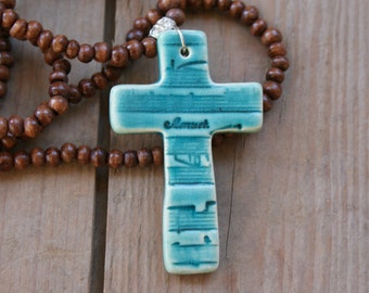 Teal ceramic cross necklace with brown wooden beads