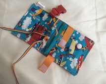 Airplane Busy blanket - a buckle, snap, zip, Velcro, and button toy - fine motor skills practice