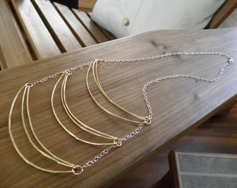 "Necklace... ""Sunlight"" hammered brass wire suspended on a sterling silver chain."