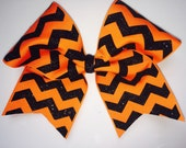 """Cheer Bows for sale; 3"""", 3 inch cheer bow with black glitter chevron on orange grosgrain ribbon"""