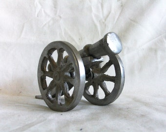 BOOM! vintage field gun, cast metal cannon, wheel, cart. artillery corps. Military, Adult war toy, battle, Napoleonic wargame, desk decor