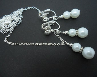 A hand made white glass pearl  necklace and  clip on earring set.