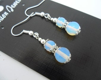 A pair of pretty hand made opalite   dangly earrings.
