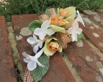 Flower corsage, Peach Rose and Cream Stephanotis. Weddings, Prom or Events.