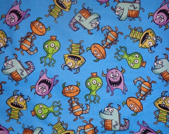 Blue Monster Toss Flannel Fabric by the Yard