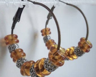 Viking Style Hoop with Amber colored glass rings  -  #177  vk