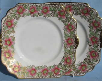 Glorious pair of burnished gold and pink Gladstone China cake plates