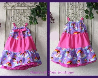 Back tie dress made from Dora and Boots fabric, back tie, 3 tiered ruffle, toddler