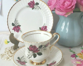 Vintage tea cup and saucer trio with red roses by Lubern with 22 kt gilding.