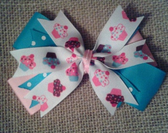 Blue and pink cupcake bow