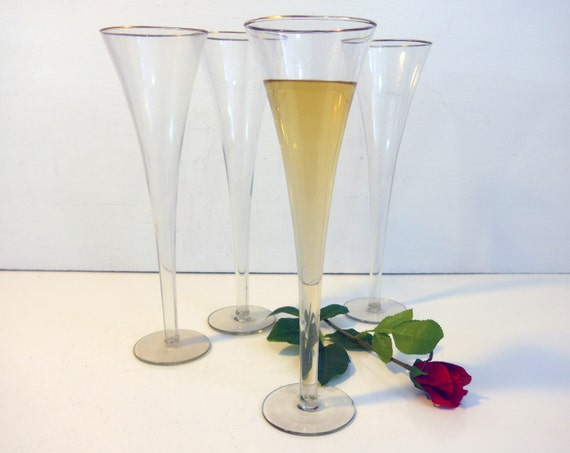 Set of 4 vintage very tall champagne flutes by for Thin stem wine glasses