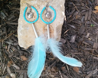 native american beaded hoop earrings with silver plated pewter turtles and light blue feathers tinvjingle cones