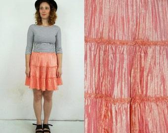 90's vintage women's peach high waisted mini skirt